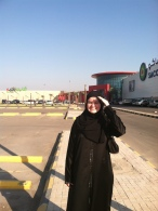 My daughter in front of the mall